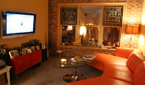 The stained glass to the right of the wide screen tv.