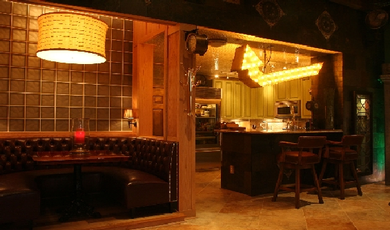 The stained glass cabinet door to the right of the bar.