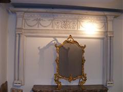 White wooden mantel