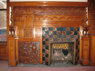 Whimsical maple mantel with owl motif