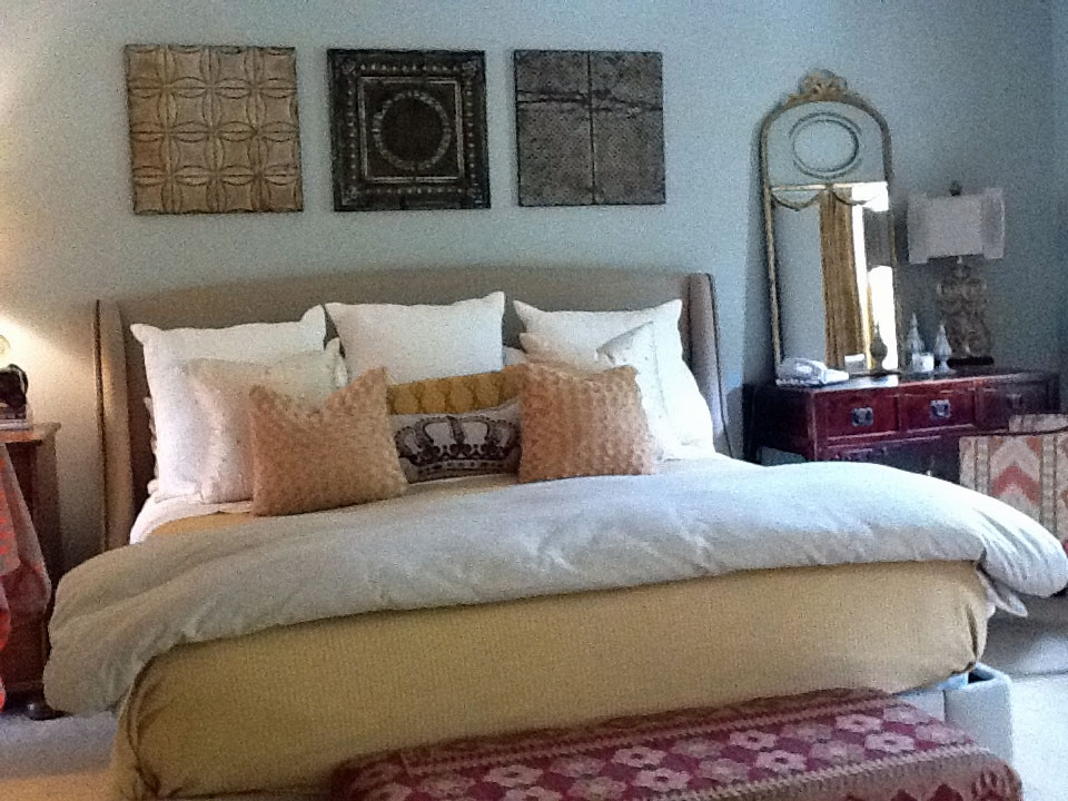 Antique tin panel display accenting a bedroom