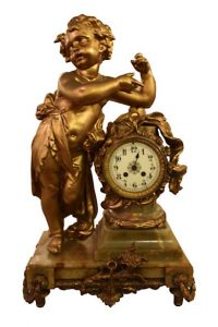 Decorative French bronze mantle clock on an onyx base with large spelter Cherub.