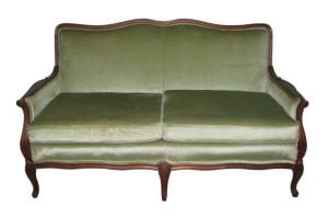 Early 20th century green love seat with a carved wood frame
