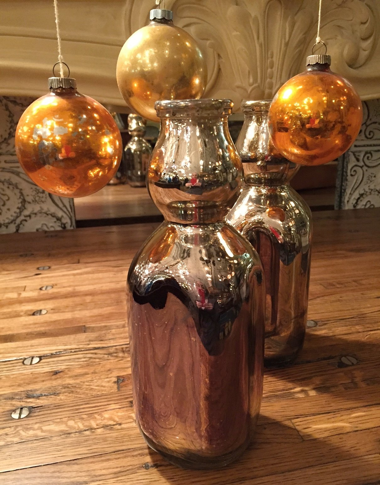 Great holiday idea... hand-silvered vintage milk bottles
