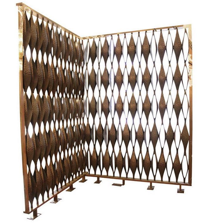 Completion of this massive cast bronze room divider took place in 1964