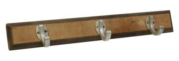Three Aluminum Hooks on Wood Plank