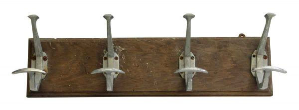 Four French Aluminum Hooks on Plank
