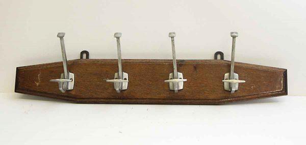 Four Aluminum Hooks on Plank