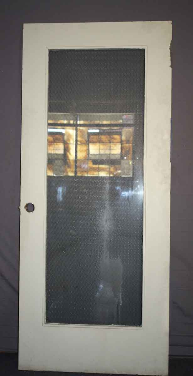 wooden door with chicken wire glass