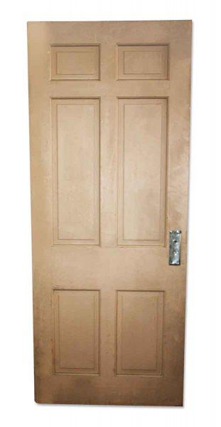 Tan Door with Six Vertical Panels
