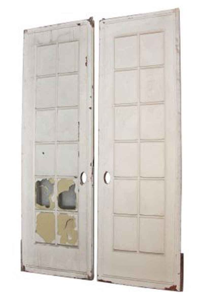 Pair of White Pocket Doors with Glass Panel