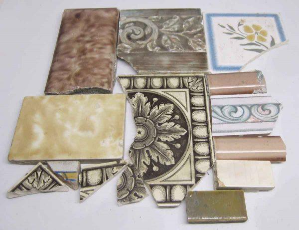 Set of Fourteen Brown Assorted Tiles
