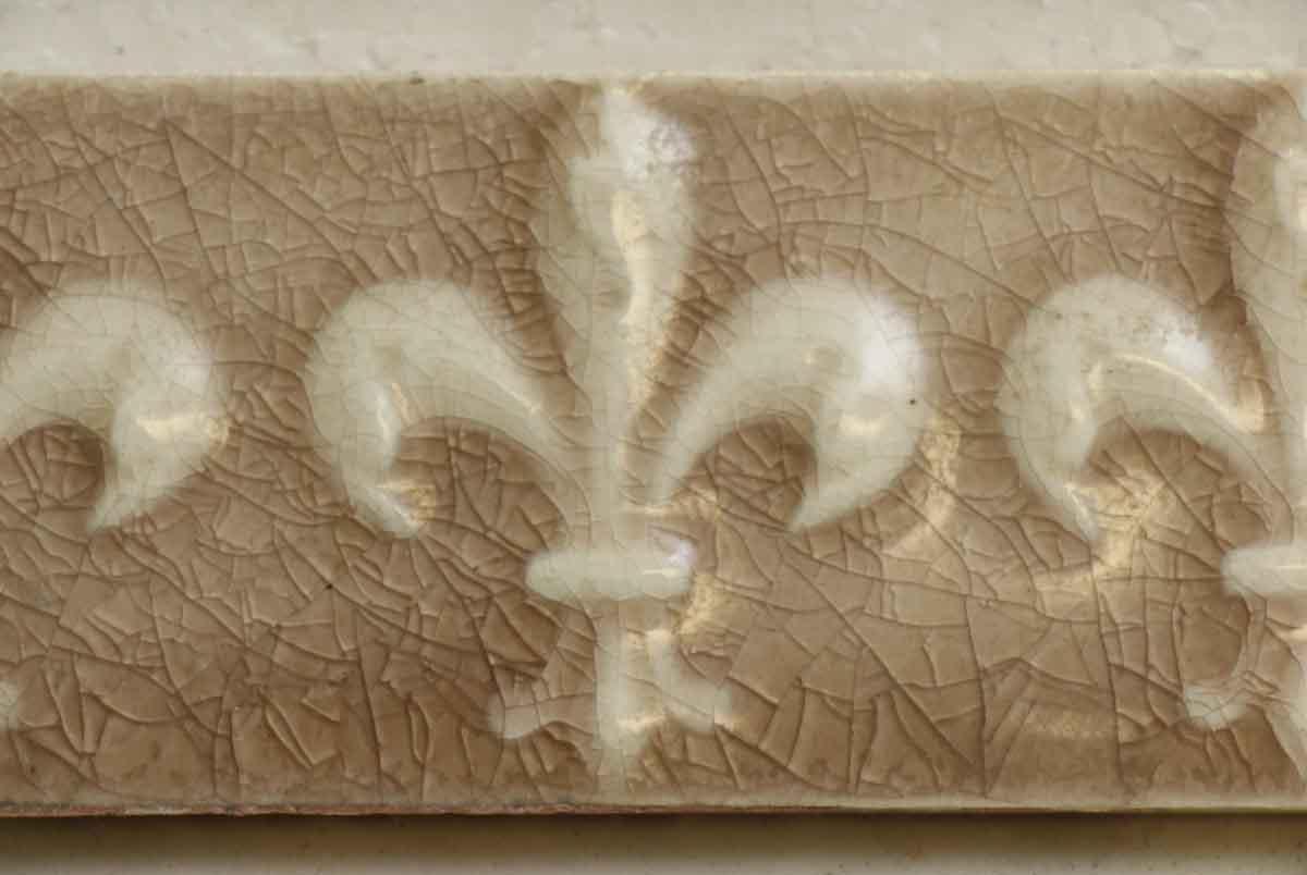 Set Of Four Led Tan Fleur De Lis Ceramic Tiles