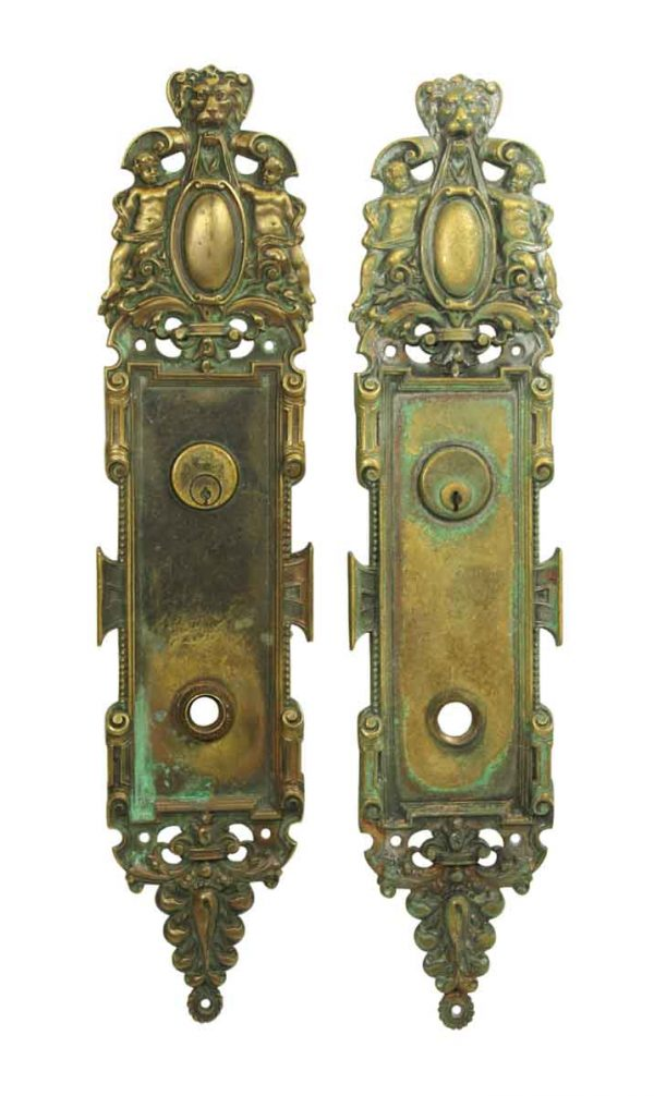 Beautiful Pair of Figural & Ornate Backplates