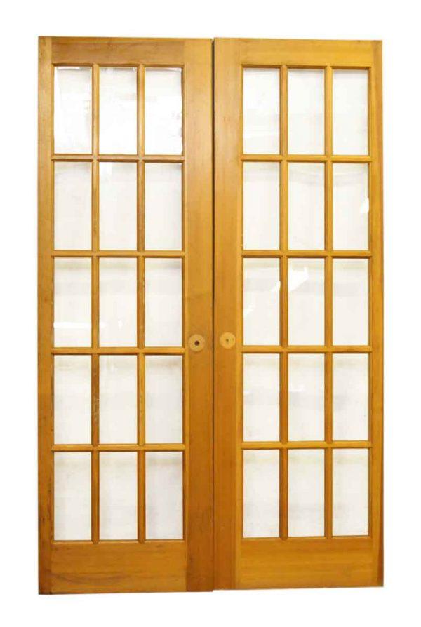 Pair of Fifteen Glass Panel Doors