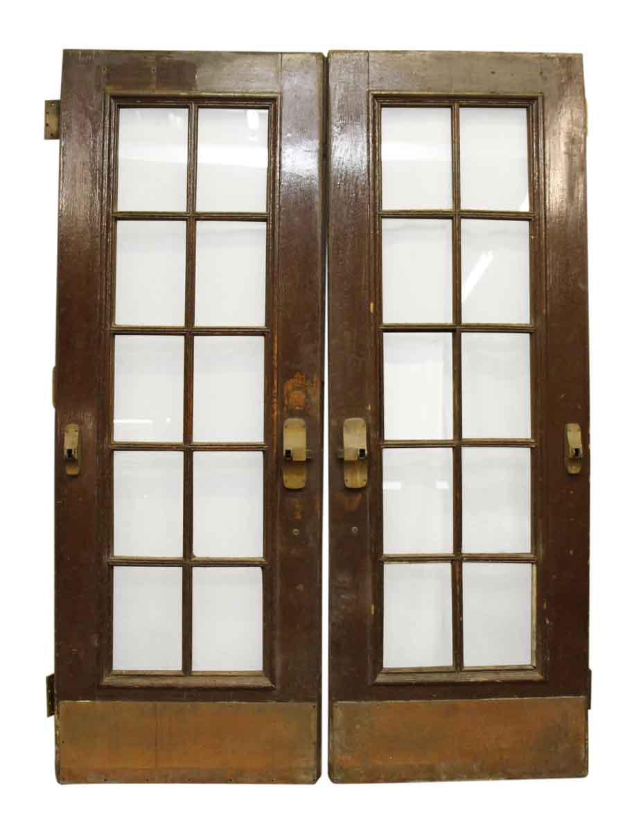 Double french doors with large bronze pulls kick plates for Large french doors