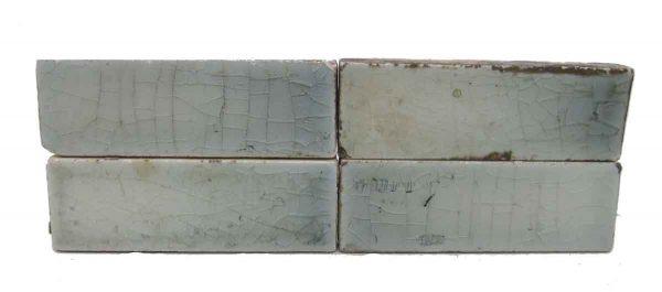 Set of Four Small Light Blue Tiles