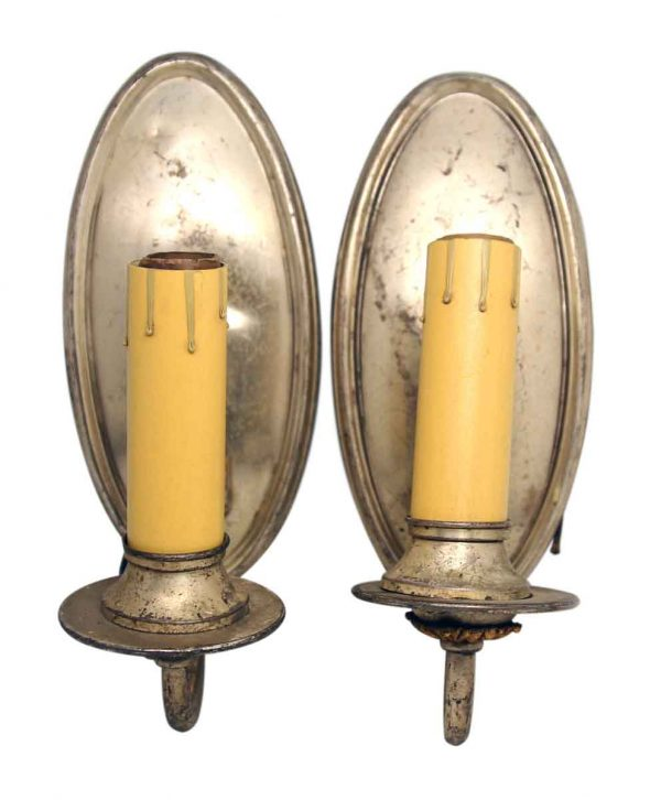 Pair of Worn Oval Sconces with Silver Plated Finish