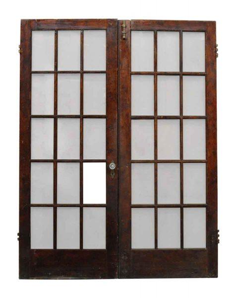 Pair of Eighteen Glass Panel Doors