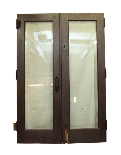 Pair of Dark Wood Doors with Glass Panel
