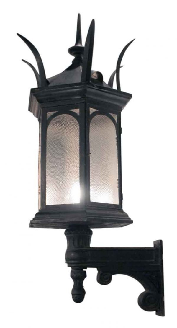 Turn of the century iron sconces with spike finials