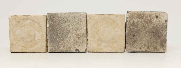 Set of Four Small Light Colored Tiles