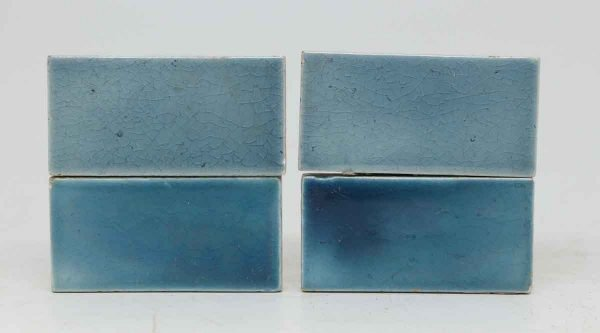 Set of Four Blue Tiles with Crackles