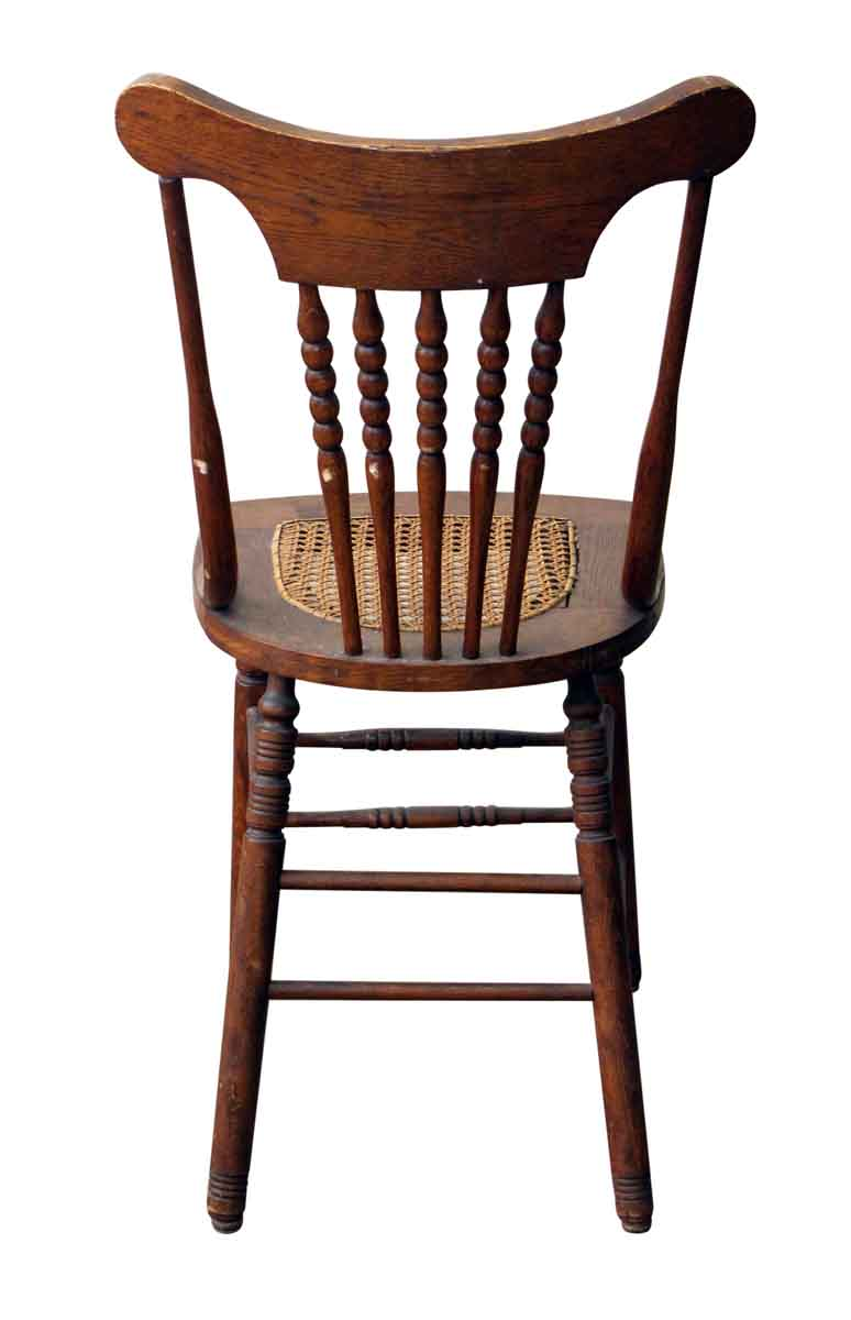 Pair of carved wood chairs with wicker seat olde good things
