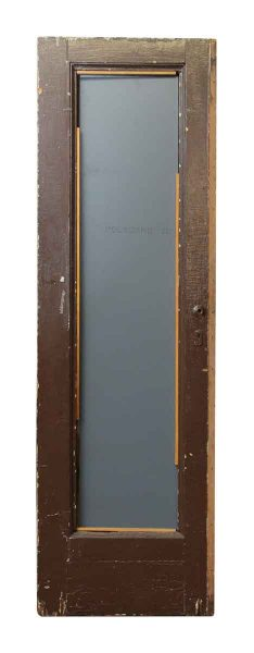 Single Panel Wood Door with Carved Detailing on One Side