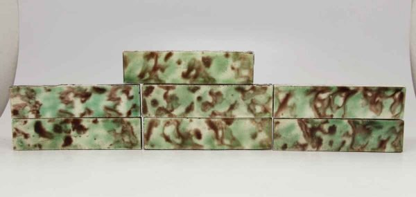 Set of Seven Green and Brown Decorative Tiles