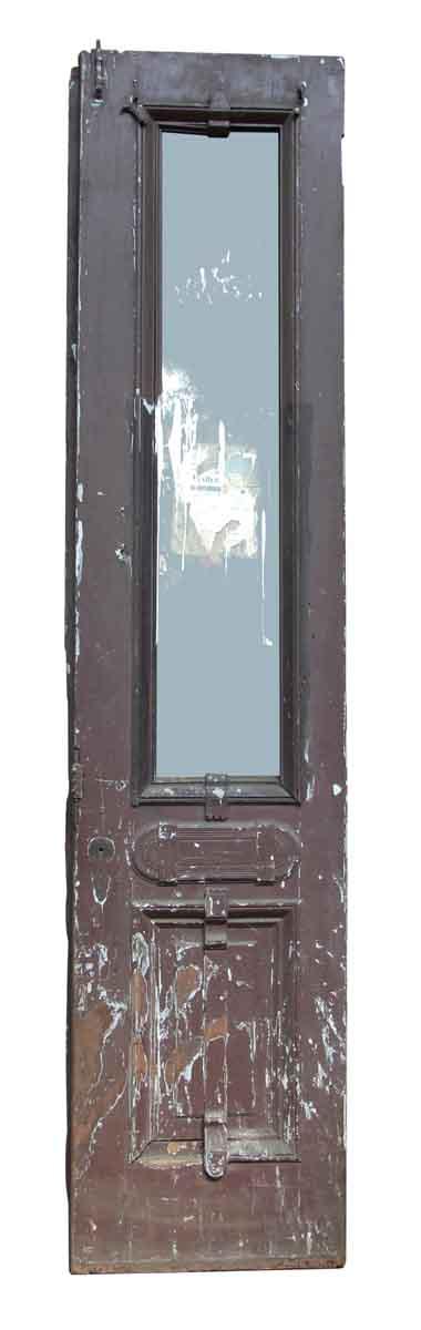 Worn Brownstone Door with Glass Panel