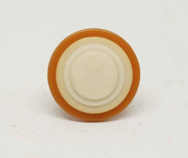 Round Burnt Orange & Tan Plastic Knob