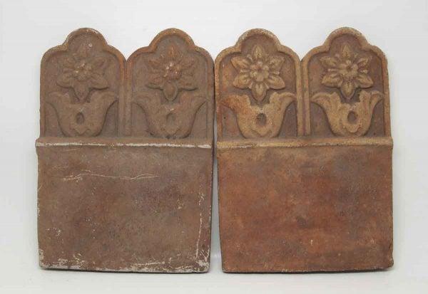 Set of Four Floral Terra Cotta Pieces