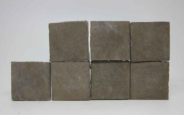 Set of Seven Brown Square Floor Tiles