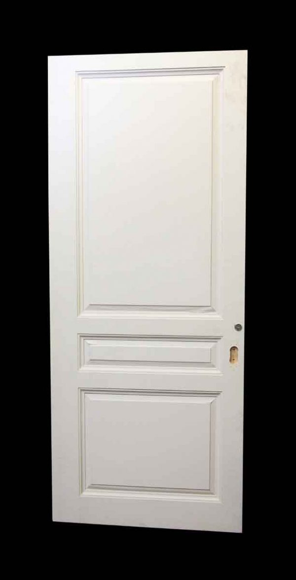 Wide White Three Panel Wood Door