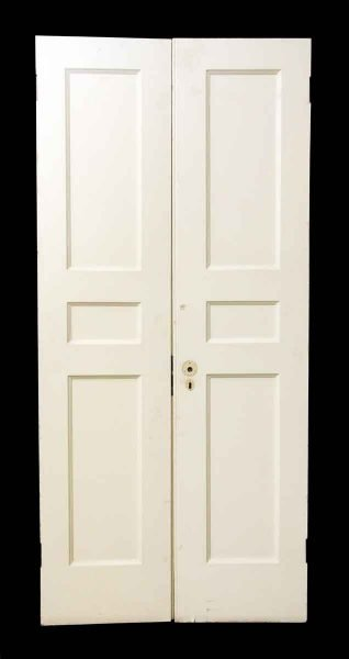 Pair of Three Panel Wooden Closet Doors