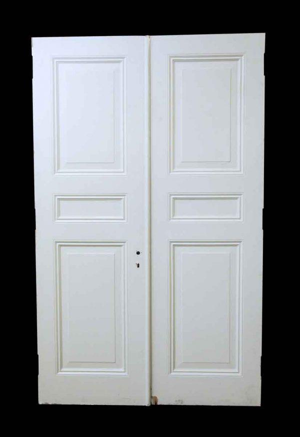 Pair of White Wooden Triple Panel Doors