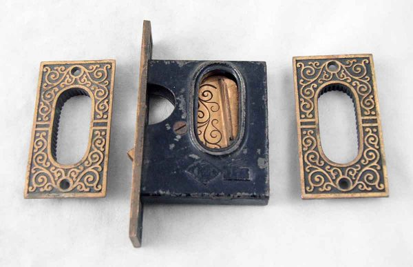 Ornate pocket door hardware with mortise lock