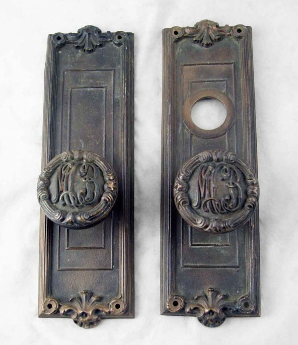Cast bronze entry set with 'MB' initials