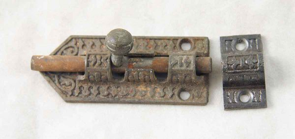 A decorative ornate Victorian slide bolt
