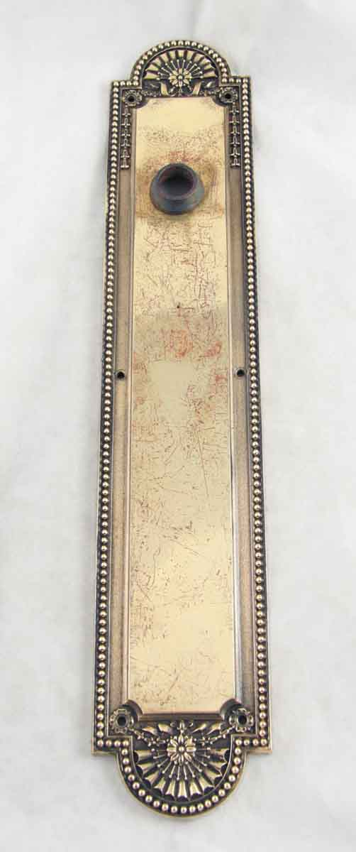 Ornate brass backplate