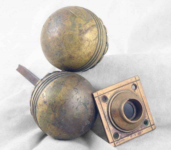 Unusual round cast bronze knob set