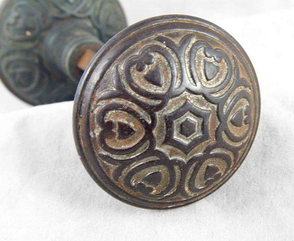 Victorian bronze door knob with center motif