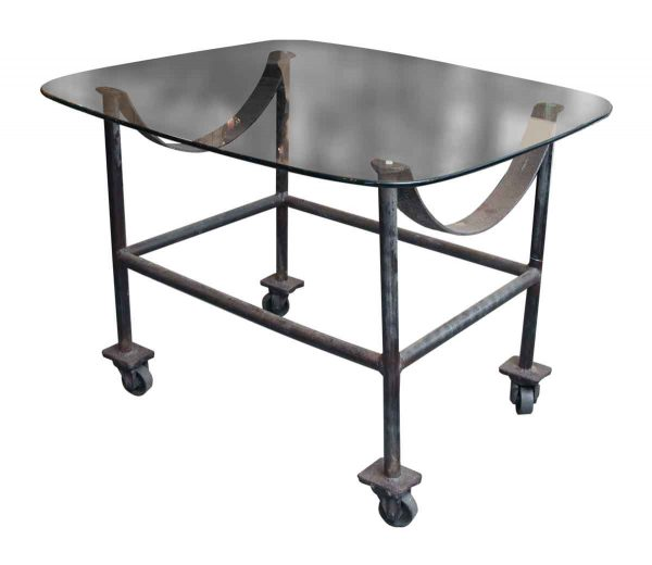 Glass Top Table with Cast Iron Wheeled Base - Altered Antiques
