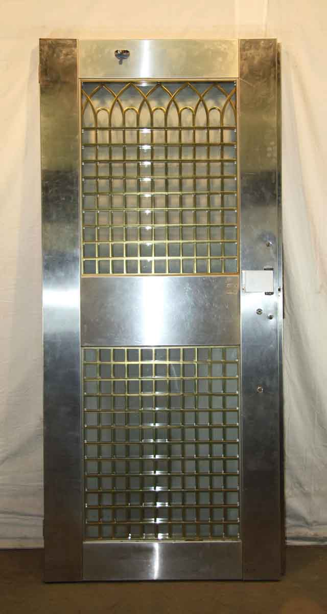 Stainless Steel Entry Door With Decorative Brass Grill