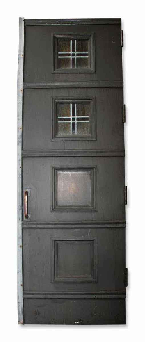 Oversized Bronze Entry Doors With Stained Glass Detail