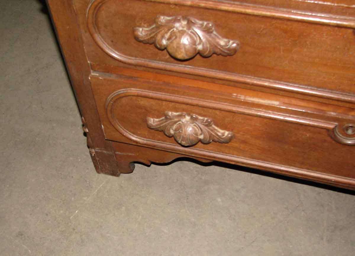 Th century walnut dresser with carved wood handles