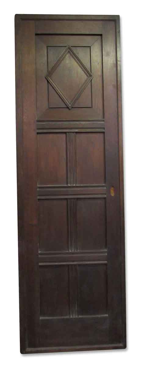 Tall Walnut Door with Decorative Carvings - Pocket Doors