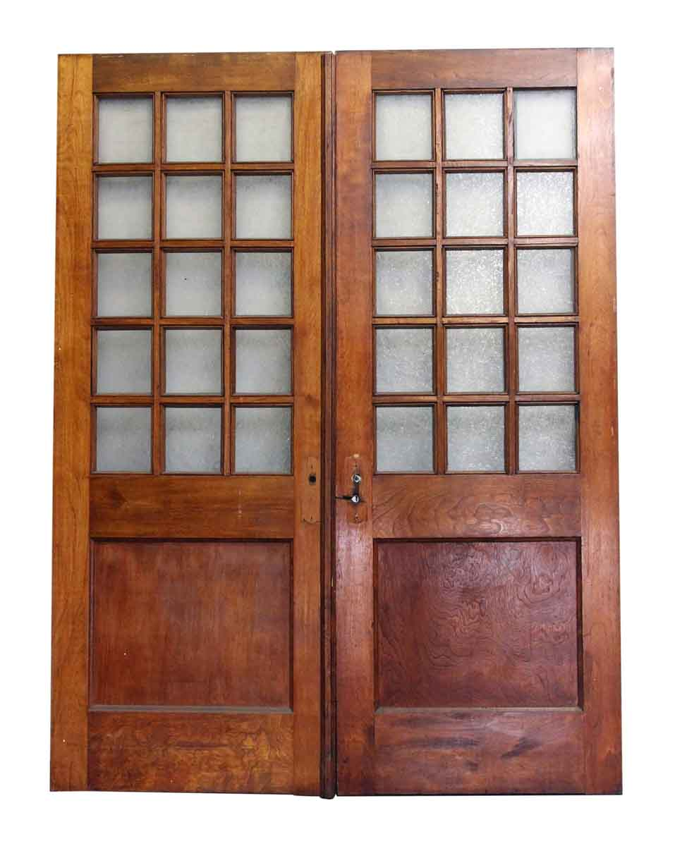 Double wooden doors with multiple textured glass panels for Double glass doors