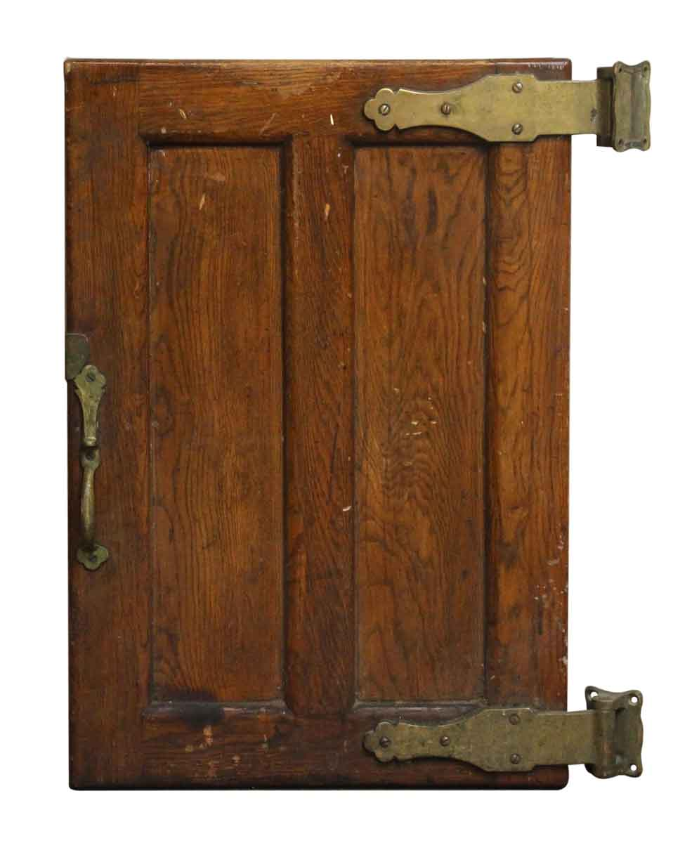 Old wooden refrigerator door with bronze hardware olde
